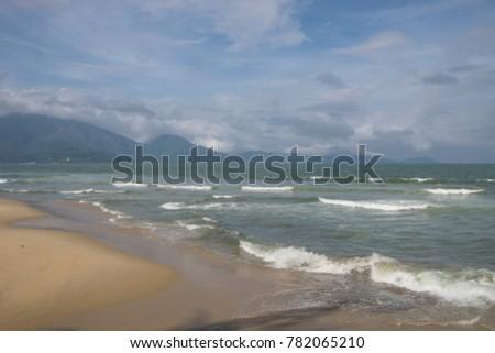 Beach with mountain backdrop Vietnam #782065210