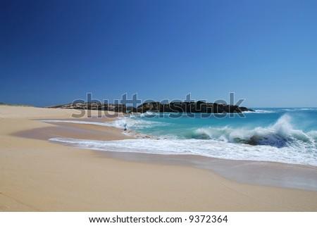 beach with ocean surf in Australia