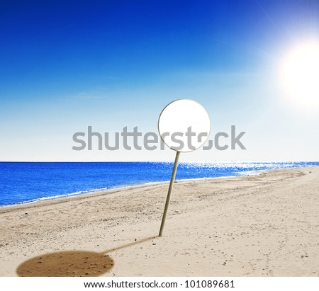beach , with perfect blue water and blue sky and blank sign