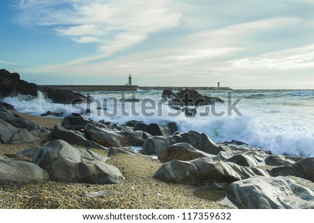 Beach with rocks and a cloudy sky. #117359632