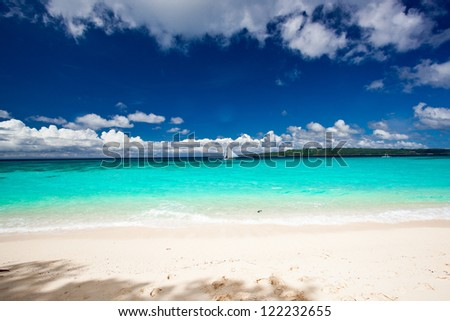 Beach with sailboat in ocean, Philippines