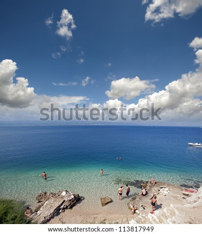 Beach with swimmers in Croatia