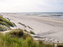 Beach with tire tracks and dunes at North Sea coast of West Frisian island Vlieland, Friesland, Netherlands