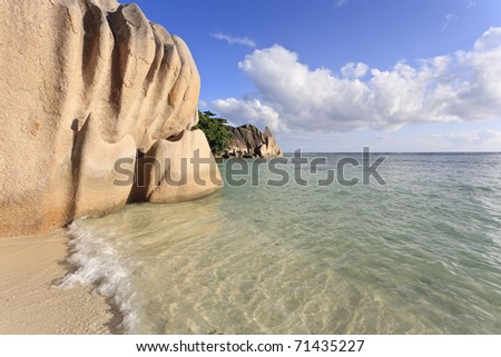 Beach with typical granite rock formation on the island of La Digue, Seychelles, Indian Ocean