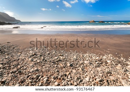 Beach with volcanic stones, Lanzarote, Canary Islands, Spain - stock photo