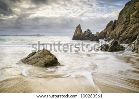 Beach with water and rocks. The picture was taken on a beach in Spain.