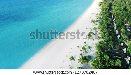 beach with water bungalows at Maldives #1278782407
