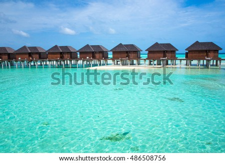 beach with water bungalows at Maldives #486508756