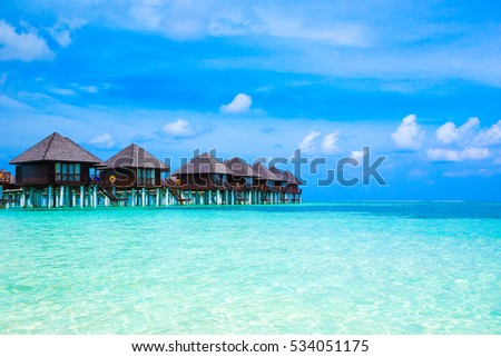 beach with water bungalows at Maldives #534051175