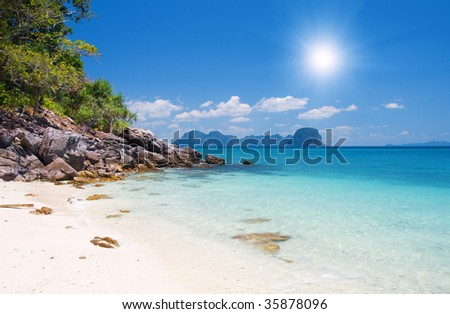 beach with white sand and tropical sea