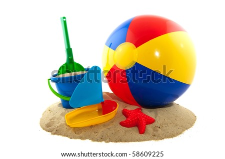Beachball with sand and bucket for the beach