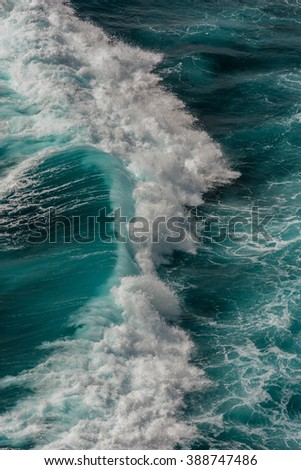 beachcomber, close up shot of ocean wave with white foam in Bali, Indonesia