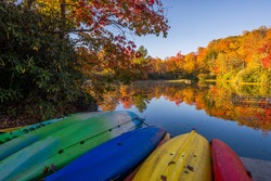 Beached kayaks and autumn color at Price Lake along the Blue Ridge Parkway in North Carolina