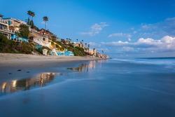 Beachfront homes at twilight, in Laguna Beach, California.