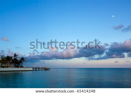beachfront hotel under beautiful clouds in Key West at sunset