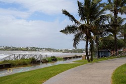 Beachfront landscape with public footpath and picnic facilities and beach access by the ocean