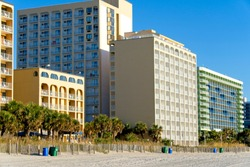 Beachfront motels located along the Grand Strand of Myrtle Beach, South Carolina with pristine sandy beaches.