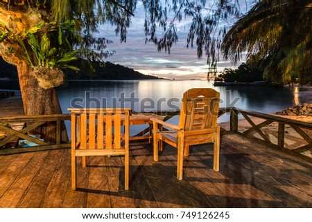 Stock Photo Beachfront view of the sunset over the Togian (Togean) islands in a very remote part of Central Sulawesi by the Celebes sea in Indonesia, Southeast Asia