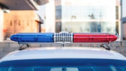 Beacon flasher on police car. Close up of red and blue sirens on police car.