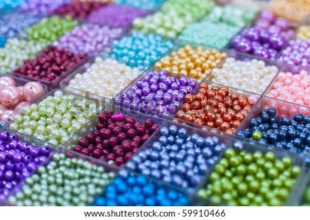 Beads in boxes on a Thai sunday market Chatuchak. Bangkok. Thailand