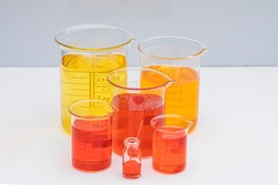 Beaker with color liquid. Solution chemistry. Laboratory beaker with colored liquid over white background.