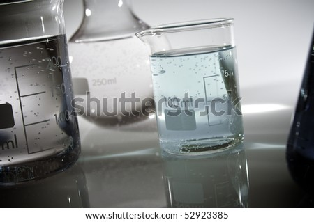 beakers backlit with white background in a laboratory