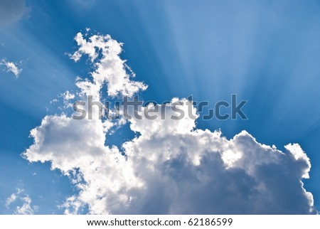 Beam of light behind the clouds