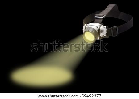 beam of light from the headlamp flashlight - stock photo