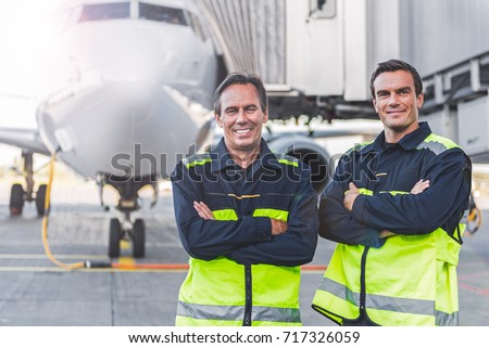 Beaming workers having job at airdrome