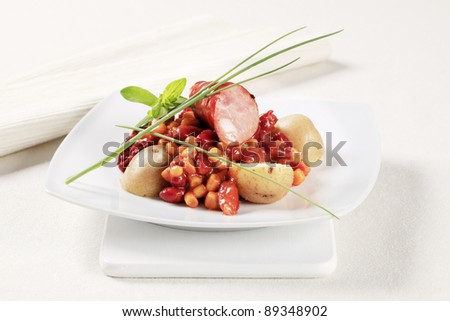 Bean and corn chili with sausage and potatoes