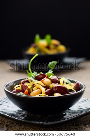 bean salad with onion, parsley and garlic in lemon vinaigrette