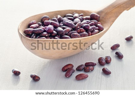 bean seeds in a wooden spoon