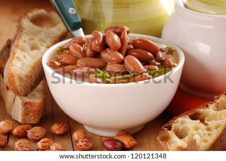 bean soup in white bowl - stock photo
