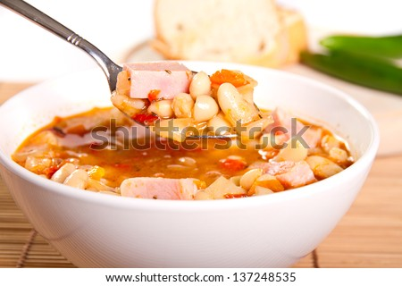 Beans and bacon soup in a bowl