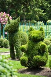 Bear and Unicorn shaped bushes in a topiary garden