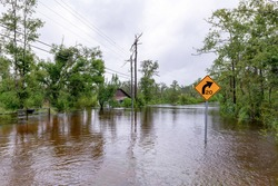 Bear creek in Bay County florida out of it's bank, flooding houses, cars and roads.