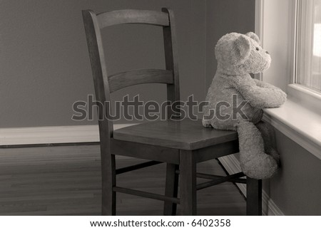 Bear in Chair Looking Out Window - stock photo