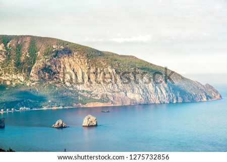 Bear Mountain or Ayu-Dag in Crimea, Russia. Scenic view of the Southern coast of Crimea near Yalta city. Landscape and nature of Crimea in summer. Cape with steep shore in the Black Sea.