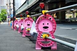Bear-shaped post of barricade at construction site, Japan