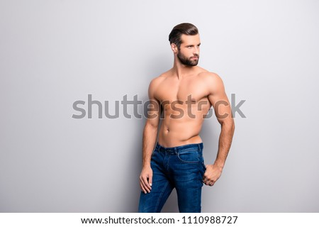 Beard bristle stubble. Portrait of handsome hot sexual strong tempting guy with perfect hairstyle, casual denim jeans holding hands in back pocket looking aside isolated on gray background copy-space
