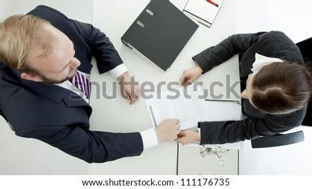 beard business man brunette woman at desk working above