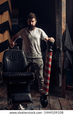 Beard man visiting hairstylist in barber shop. Brutal guy in modern Barber Shop. Barber shop. Portrait of stylish man beard. Barber - Shaves and Trims. Great time at barbershop