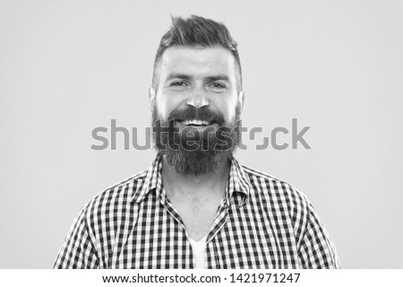 Bearded and happy. Man bearded rustic hipster stylish beard yellow background. Barber tips maintain beard. Stylish beard and mustache care. Hipster appearance. Beard fashion and barber concept.