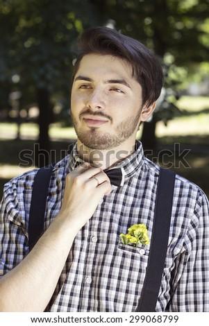 bearded beautiful groom in the park