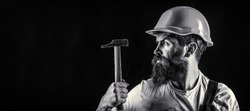 Bearded builder isolated on black background. Bearded man worker with beard, building helmet, hard hat. Hammer hammering. Builder in helmet, hammer, handyman, builders in hardhat. Black and white.