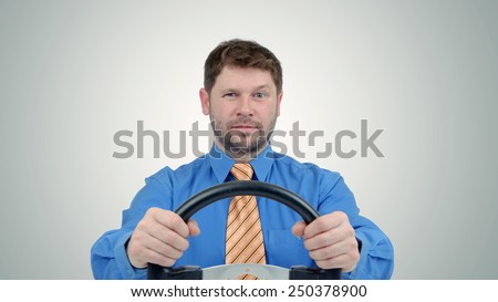 Bearded businessman with a steering wheel, auto business concept