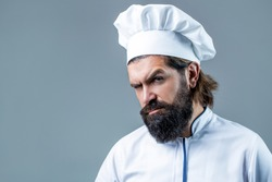 Bearded chef, cooks or baker. Bearded male chefs isolated. Cook hat. Confident bearded male chef in white uniform. Serious cook in white uniform, chef hat. Portrait of a serious chef cook.