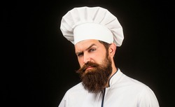 Bearded chef, cooks or baker. Bearded male chefs isolated on black. Cook hat. Confident bearded male chef in white uniform. Serious cook in white uniform, chef hat. Portrait of a serious chef cook.