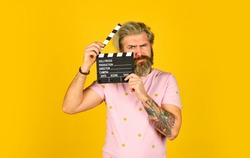 bearded guy with film making clapperboard. movie time. Film director concept. catch the feeling. Professional Actor Ready for Shoot. ready to film new scene. man with movie clapper.
