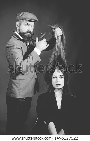 Bearded Hairdresser making hair styling and cut. Hairdressers work. Barber shop. Barbershop design. Barber scissors